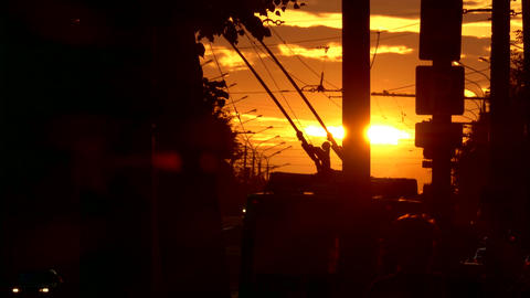 1080p Trolleybus Crosses Frame Against Sunset Revealing Picturesque View Of Footage