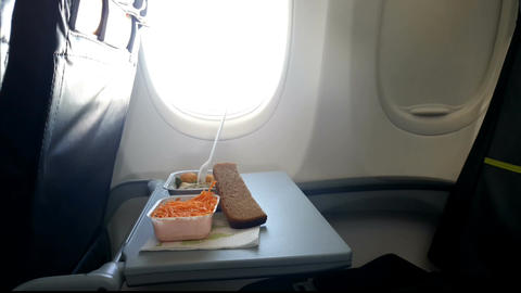 Lunch on the flip table in the plane Footage