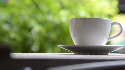 Steaming coffee cup on a rainy day Footage