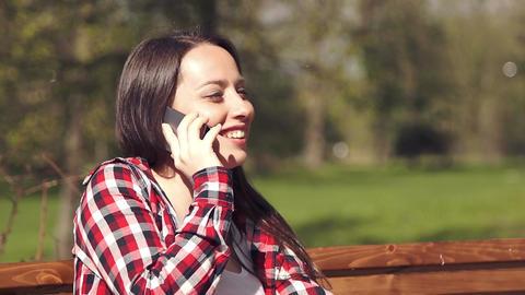 Teenage girl having fun talking on the phone Footage