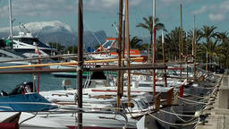 Spain Mallorca Island Port d'Alcudia 006 snow covered mountain and yacht harbor Footage