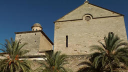 Spain Mallorca Island Alcudia 028 church nave above city wall with palm trees Footage