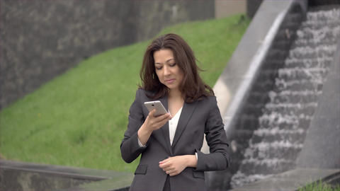 Businesswoman in suit talking on the phone Footage