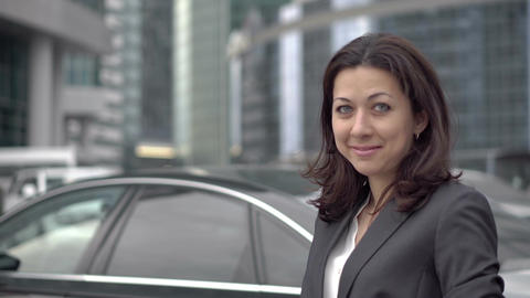 Successful woman in a business suit standing Filmmaterial