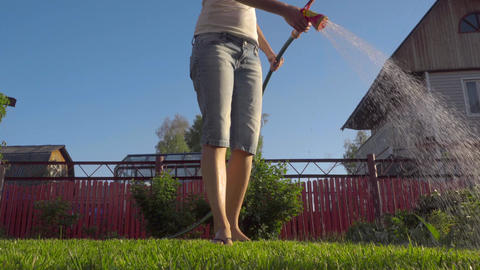 Woman watering the lawn Footage