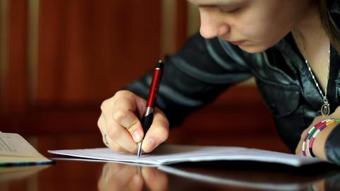 girl doing homework. 4 Stock Video Footage