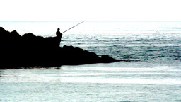 FISHING ON THE ROCKS Stock Video Footage