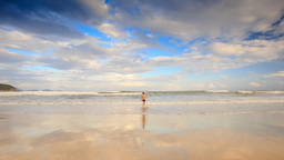 Backside Little Boy Runs to Shallow Sea Water Towards Waves Footage