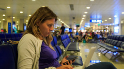 Closeup Blond Girl Works on Laptop Answers sms in Terminal Footage