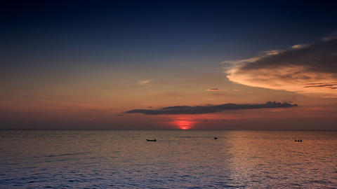 Boats Silhouettes Drift at Sunset Sun Disappears behind Horizon Footage