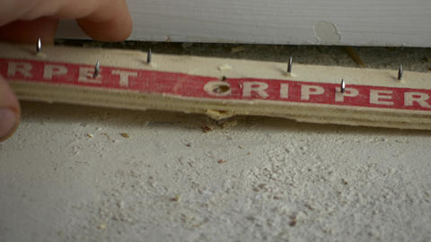 Pulling up carpet gripper with crowbar, 4K Footage