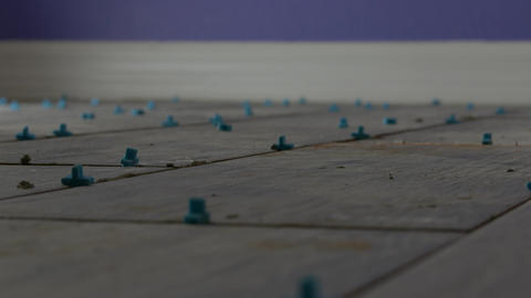 Low angle of finished tile floor with blue spacers, 4K Footage