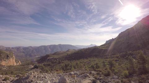 Aerial shot over mountain ranges on sunny day - Marina Baixa, Costa Blanca, Alic Footage