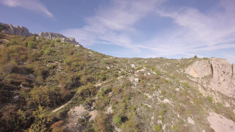 Aerial view over hikers that it's climbing the mountain - Marina Baixa, Costa Bl Footage