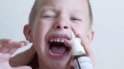 Treat The Child's Nose Spray Slow Motion Footage