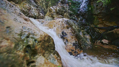 Closeup Small Foamy Mountain Waterfall Flows into River Footage