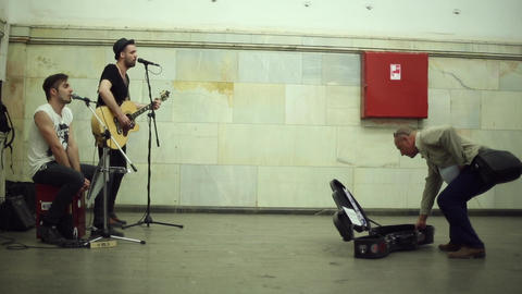 Street musicians playing music Footage