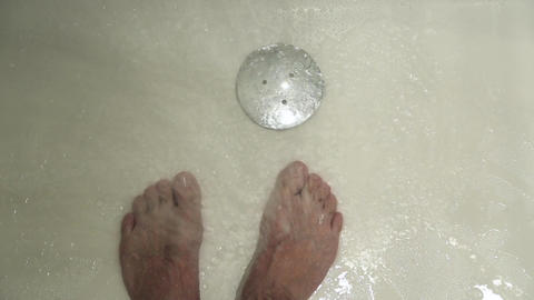 The water flows to the legs of a man Footage