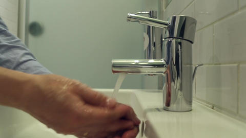 Man washes his hands with soap Footage