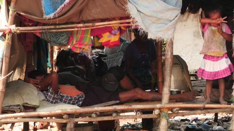 Poor people in Myanmar village - smooth zoom Footage