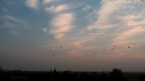 air balloons hyper lapse and zoom at sunrise under Bagan of Myanmar Footage