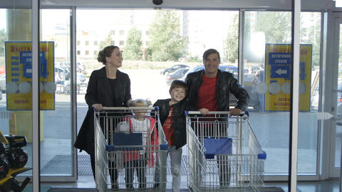 Joyful Family Have Fun and Come into Supermarket Footage