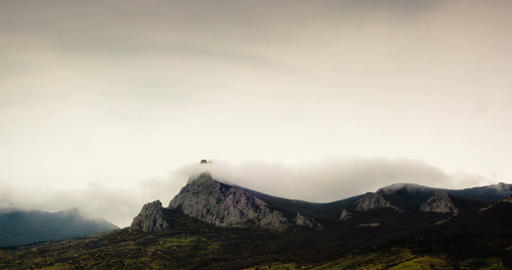 Clouds fly over a mountains. Time-lapse Footage