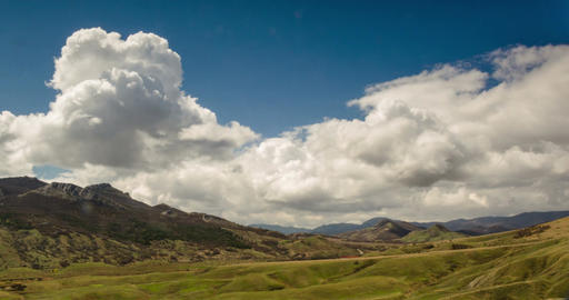Clouds form over the valley in warm sunny day Live Action