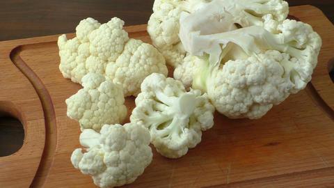 Cauliflower on a chopping board Footage