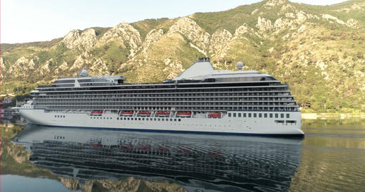 Cruise liner goes along the bay and is reflected Footage