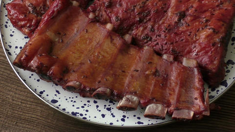 Barbecue pork ribs served on a platter Live Action