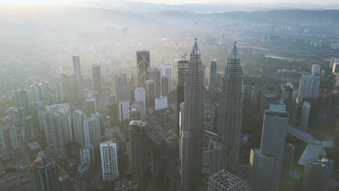 4k b-roll cinematic footage of drone flying above Kuala Lumpur city skyline Archivo