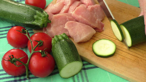 Raw fresh meat on cutting board and fresh vegetables Live Action