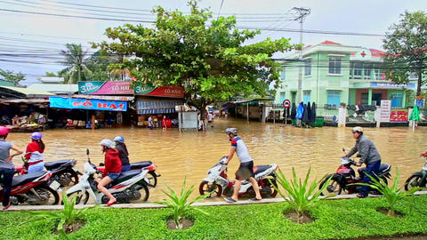 Flood in City Scooters Drive in Water People Barefoot in Vietnam Footage