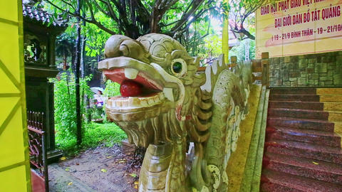 Decorative Wooden Dragon by Steps to Buddhist Temple Footage