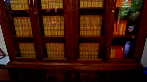 Close View Large Religious Books Bookcase in Buddhist Temple Footage