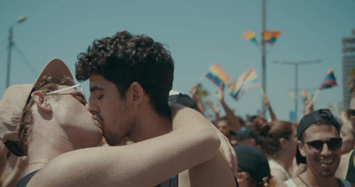 TEL AVIV, ISRAEL, June 9th 2017. two young men kissing during the pride parade Footage