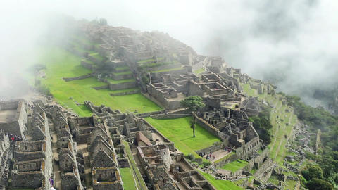 Peru Machu Picchu ancient inca ruin site Panorama with morning clouds Footage