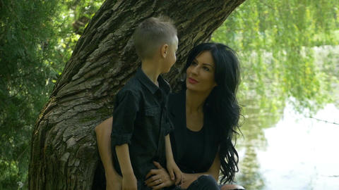 Beautiful mother and her cute little son enjoying a beautiful spring day near th Footage