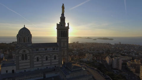 Notre-Dame-de-la-Garde hill at sunset filmed by drone at sunset, Marseille, Fran Footage