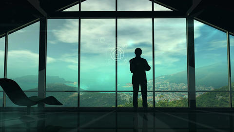 A man is standing by the window viewing IOT infographics elements Animation