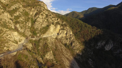 mountain road and valley at dusk in the back country of Nice, filmed by drone, L Footage