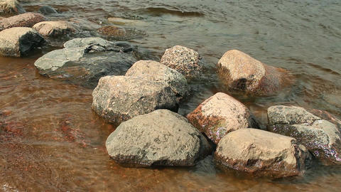 smooth boulders washed by waves Footage
