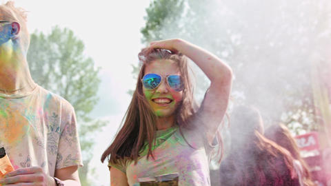 Young People Smearing Each Other with Powder Paint GIF