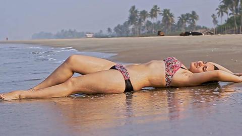 Slim Sensual Woman in Swimsuit Relaxes on Ocean Beach Footage