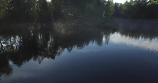 Morning mists at dawn on a low mountain pond in Corrèze, Villemonteix, France Footage