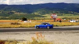 Blue racing car drifting the turn during a race Footage