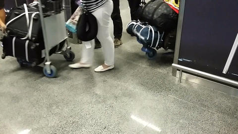 Tourists leaving airport terminal with luggage after plane arrival, travel Footage
