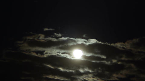 Thick cumulus clouds hiding full moon at midnight, mysterious sky, astronomy Footage
