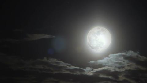 Bright moon ball under starry shade illuminates fallen asleep town protecting it Footage